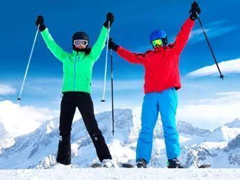 Skiers with equipment rented from Delpero ski rental