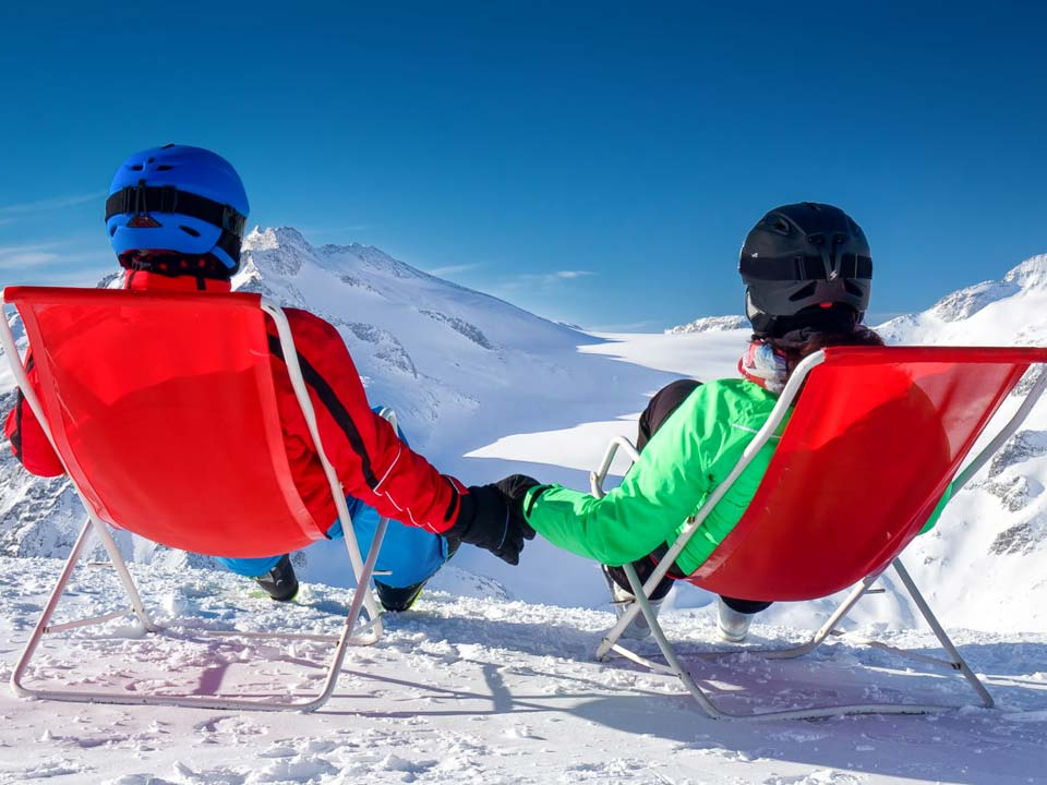 skiers relaxing on the slopes of the Tonale pass